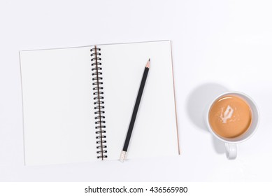 Blank Notebook with Pencil and coffee cup on White Background.Top view