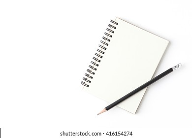 Blank notebook with pencil isolated on white background.