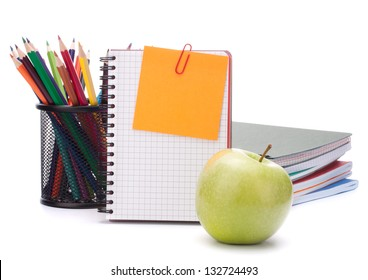 blank notebook sheet and apple. Schoolchild and student studies accessories. Back to school concept.