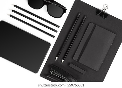 Blank notepad with clips, pens and glasses flat lay.