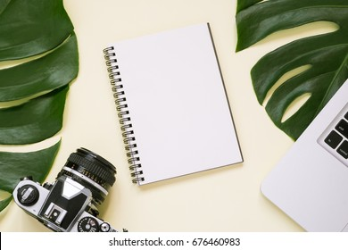 blank notepad with laptop, camera. planning traveler.flat lay ,top view.