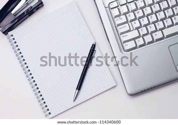 blank notepad and laptop in the office