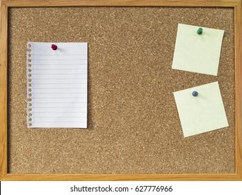 Blank notepad on brown cork board, notice board