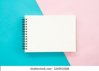 Blank notepad on pastel background