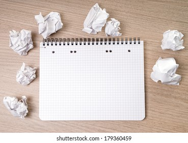 blank notepad on a table / blank writing pad