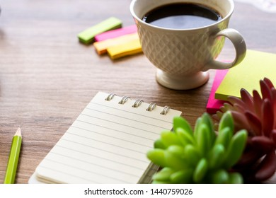 Blank notepad on wood table for Idea space