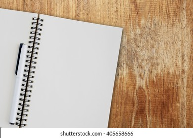 Blank notepad on wooden table.