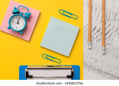 Blank notepads message sticky note letter size sheet clipboard markers small alarm clock clips wakeup wooden retro background empty text important events home office school