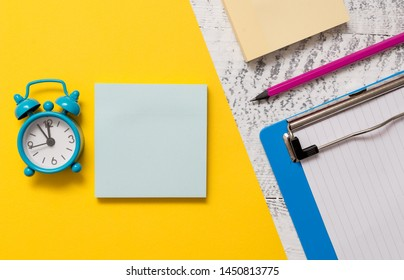 Blank notepads message sticky note letter size sheet metal clipboard marker small alarm clock wakeup wooden retro background empty text important events home office school