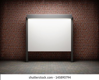 Blank notice board on brick wall