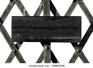 Blank oblong wooden  board painted black on Victorian flat metal bars in diamond shaped pattern. (With clipping path)