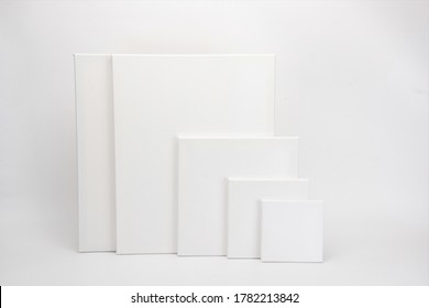 Blank oil canvases of different sizes on a grey background