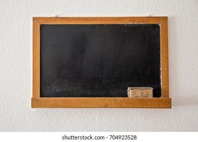 Blank old blackboard with eraser. School