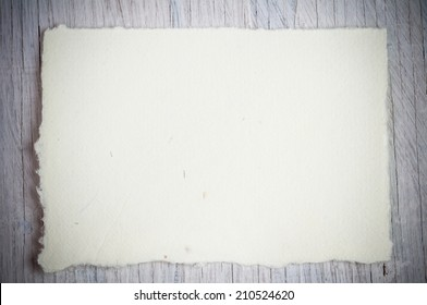 Blank old paper on wooden background
