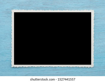 Blank old photo and space for text on a wooden blue background