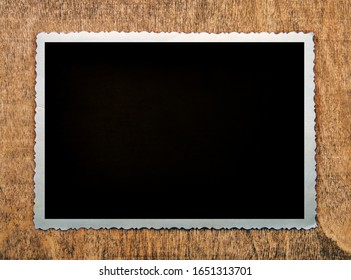 Blank old photo and space for text on a wooden background