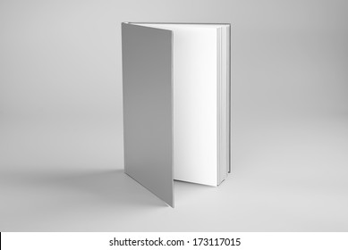 Blank open book standing over gray background