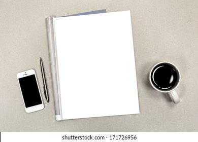 Blank open magazine isolated on textured background with phone and cup of coffee