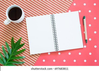 blank open notebook with a cup of coffee, pen on colorful background.view from above