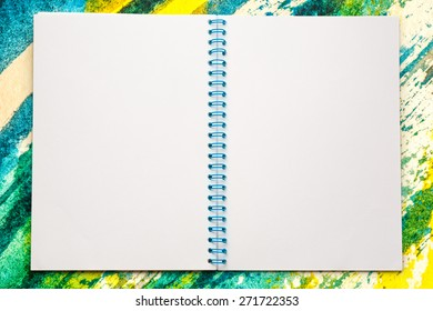 Blank open notepad on the watercolor background