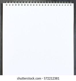 Blank open sketchbook on wooden table