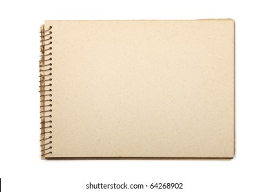 A blank open wide aged notebook with recycled paper. Isolated on white with clipping path.
