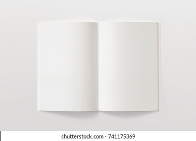 Blank opened Magazine or Brochure isolated on white. Pages top view. Mockup template for your showcase.