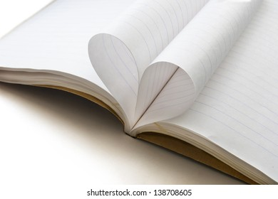 Blank opened notebook in line with sheets folded in form of a heart