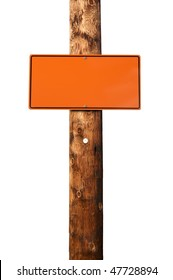 Blank orange construction sign on wooden electric pole