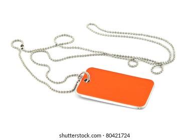 blank orange dog tag on white background