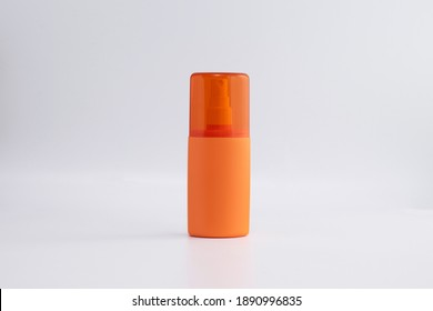 blank orange skincare pump mock up on background for UV protection product with copy space