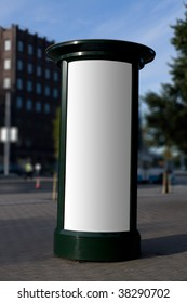 Blank outdoor advertising column with place for add copy samples. Clipping path included.
