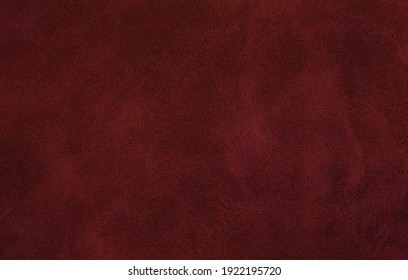 blank page of leather texture background with rough and grunge skin, full frame. Close up detail of textured sheet of dark red color organic art background. background of rough fabric red color.