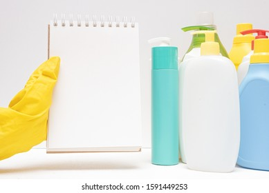 Blank page notepad and detergent bottles on white background. Laundry tips mock up.