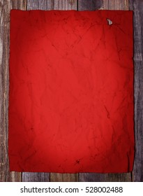Blank page of old red vintage paper on wooden background