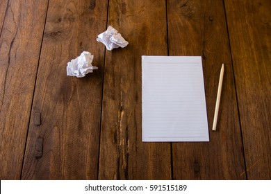 Blank page of paper on brown table