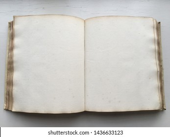 Blank pages made of rag paper in a manuscript from the middle of the eighteenth century, placed on a white background