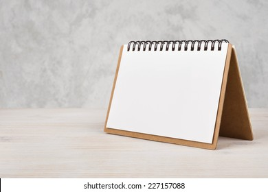 Blank paper calendar on wooden table