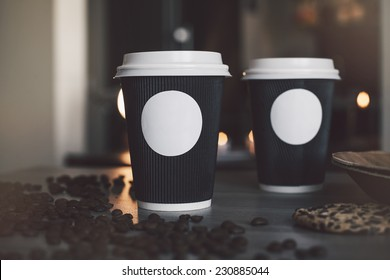 Blank paper cup of coffee in a coffee shop for the application logo