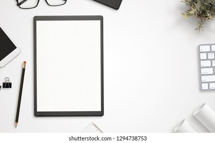 Blank paper and folder on office desk with copy space beside. Top view, flat lay.