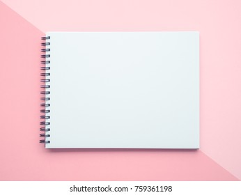 Blank paper notebook or notepad on pastel background