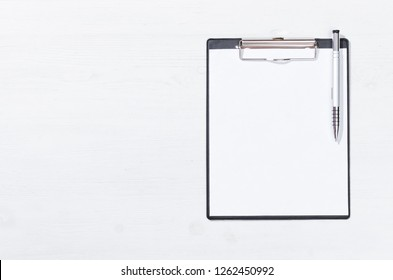 Blank paper page document with copy space on the white office table background. To do list. Resume form. Estimate.