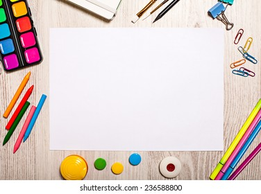 Blank paper page mockup on table with office tools
