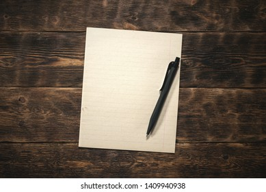 Blank paper page on a wooden board background. Old letter mockup.