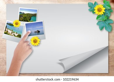 Blank paper page travel with point picture on wood background