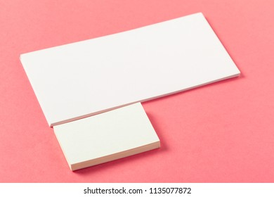 Blank paper pieces  on a colored pink background