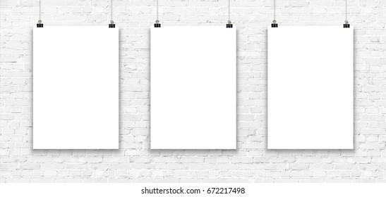 Blank paper poster mockup on a white brick wall.