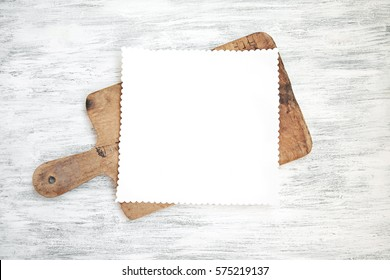 Blank Paper Sheet on Kitchen Table   Empty clear menu template on chopping board on wood background