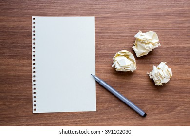 Blank Paper Sheet with Pen on Wooden Background