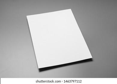 Blank paper sheets for brochure on grey background. Mock up